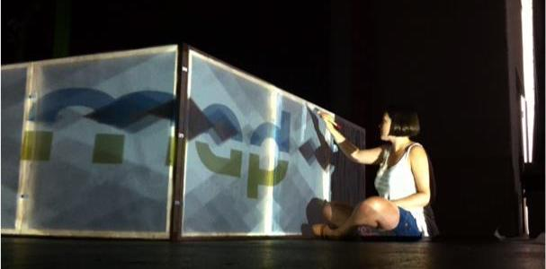 Christine Clark building projection mapping cubes at CDM