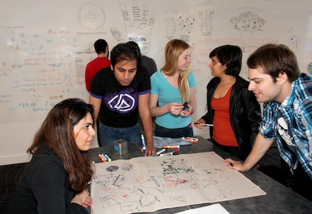 Cohort 7 students working on projects