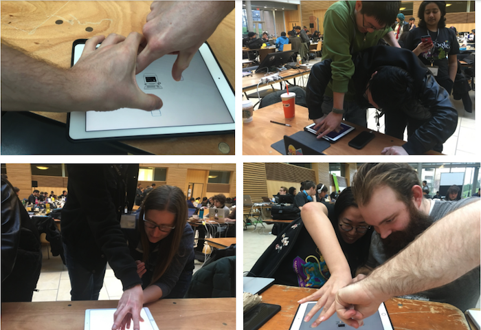 Users testing out a game at the Global Game Jam