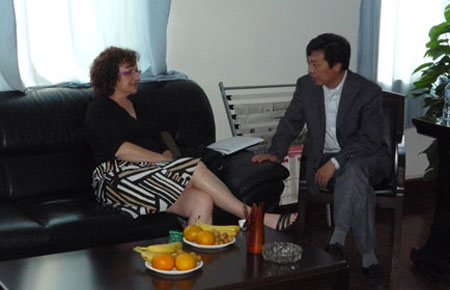 Jeannette meets with host at Wuhan University.