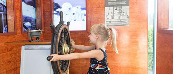 Girl at the Interactive Wheelhouse exhibit at the Vancouver Maritime Musuem