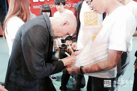 Patrick signing autographs in China
