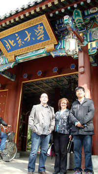 Jeannette Kopak, Dennis Chenard, and Di Zhao at the entrance to Peking University.